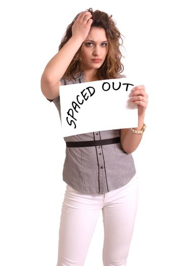 Young attractive woman holding paper with Spaced out text on white background