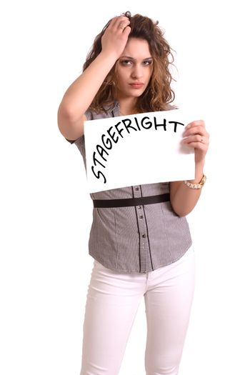 Young attractive woman holding paper with Stagefright text on white background