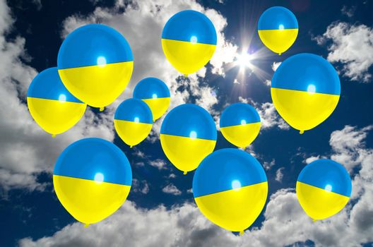 many ballons in colors of ukraine flag flying on sky