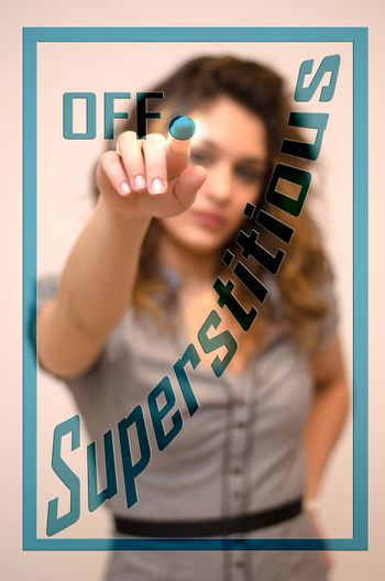young woman turning off Superstitious on screen