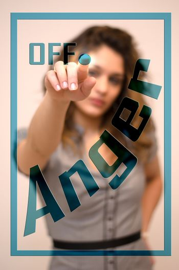 young woman turning off Anger on screen