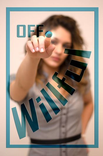 young woman turning off Willful on screen
