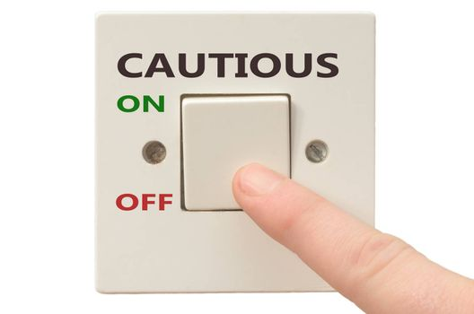 Turning off Cautious with finger on electrical switch