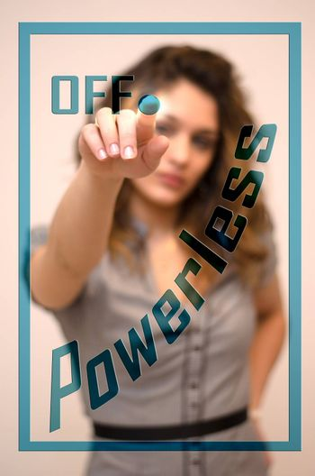 young woman turning off Powerless on digital panel