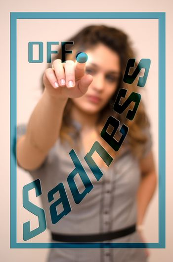 young woman turning offSadness on hologram screen
