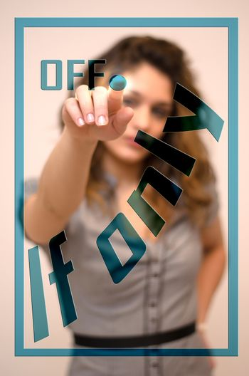young woman turning offIf only on hologram screen