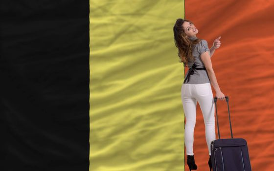 young beautiful woman is traveling to belgium