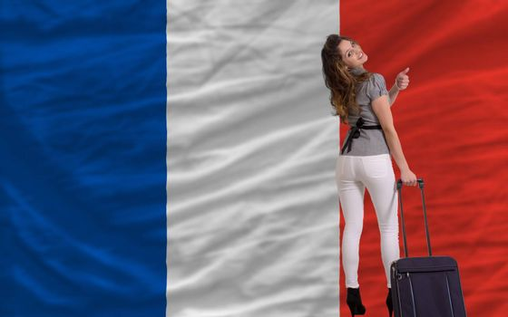 young beautiful woman is traveling to france