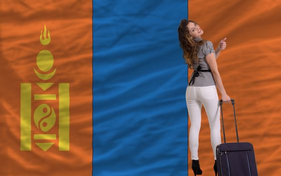 young beautiful woman is traveling to mongolia