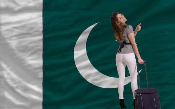 young beautiful woman is traveling to pakistan