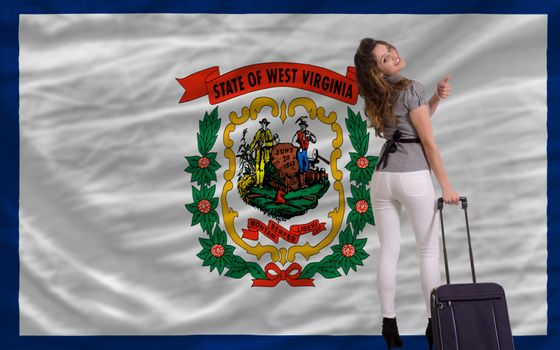 young beautiful woman is traveling to west virginia