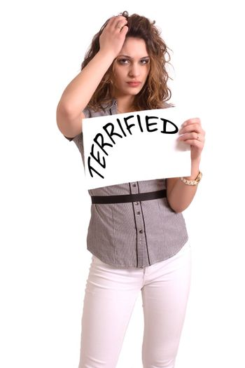 Young attractive woman holding paper with Terrified text on white background