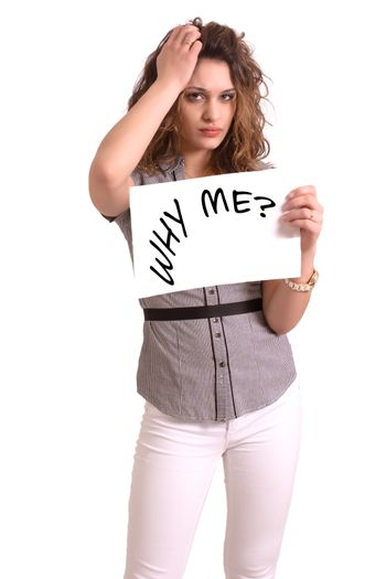 Young attractive woman holding paper with Why me text on white background
