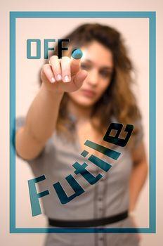 woman turning off Futile on panel