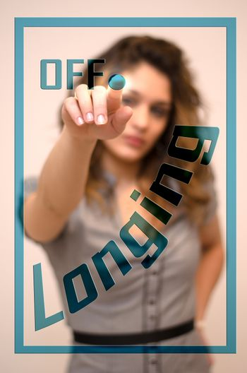young woman turning offLonging on hologram screen