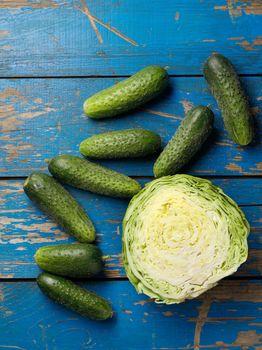Fresh adn ripe green cabbage and cucumber