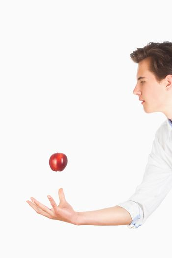 Man Tossing Red Apple in the Air