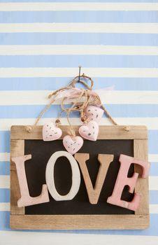 LOVE on rustic chalkboard on stripes