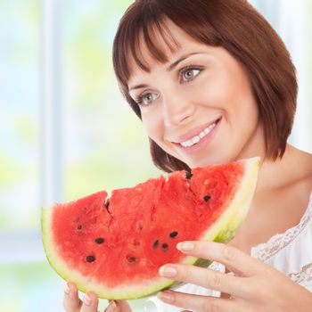 Happy woman eat watermelon
