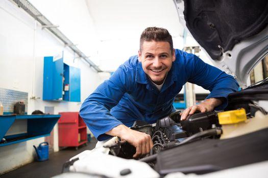 Mechanic working under the hood