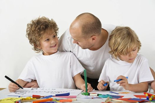 Father teaches his sons how to draw