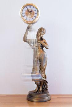 Clock with Swinging Pendulum
