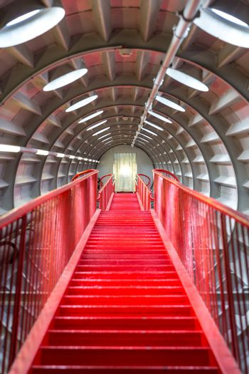 perspective of Red stairway, concept of successful career elevation