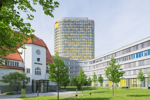 Old small clubhouse and the new ADAC Headquarters tower