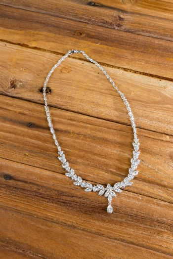 Diamond necklace on wooden background