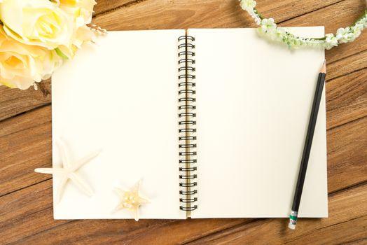 Planning paper with pen, rose headband, tiara, bouquet, starfish
