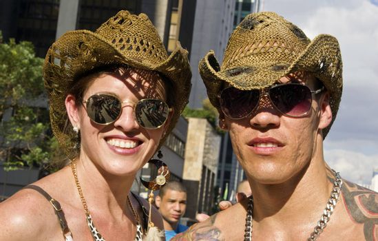 SAO PAULO, BRAZIL - June 7, 2015: Two unidentified persons  wearing costumes celebrating lesbian, gay, bisexual, and transgender culture in the 19º Pride Parade Sao Paulo.