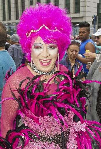 SAO PAULO, BRAZIL - June 7, 2015: An unidentified Drag Queen dressed in traditional costume celebrating lesbian, gay, bisexual, and transgender culture in the 19º Pride Parade Sao Paulo.