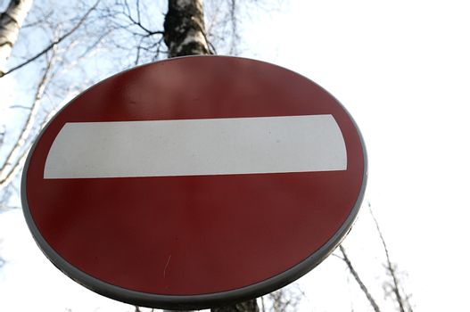 No-entry road sign standing on the road.