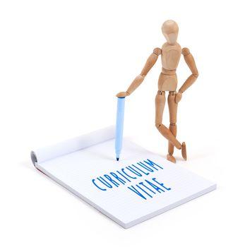 Wooden mannequin writing in scrapbook - Curriculum vitae