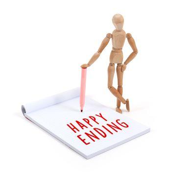 Wooden mannequin writing in scrapbook - Happy ending