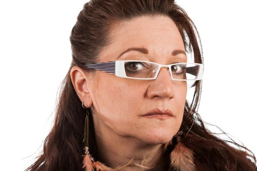 Brunette middle aged woman wearing white framed glasses with a serious expression.  Shallow depth of field.