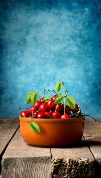 Cherries in brown plate