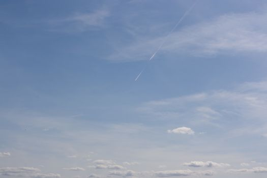 Small white clouds on blue sky