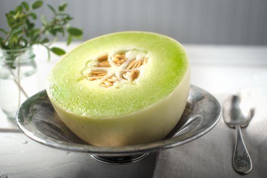 Half of Honey Dew melon in a bowl