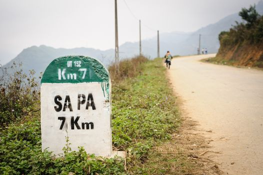 7 kilometer milestone on the highway DT 152 and direction sign to SAPA, north Vietnam.