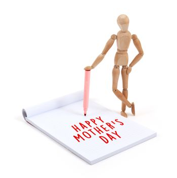Wooden mannequin writing in scrapbook - Happy mothers day