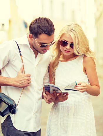 couple with map, camera and travellers guide