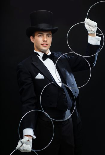 magician showing trick with linking rings