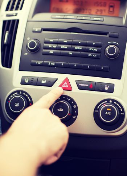man pressing car hazard warning button