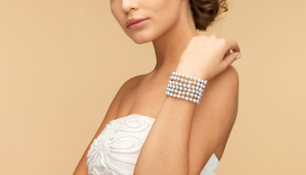 woman with pearl bracelet