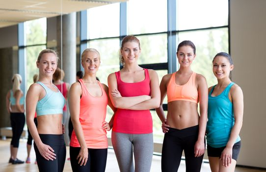 fitness, sport, friendship and lifestyle concept - group of women in gym