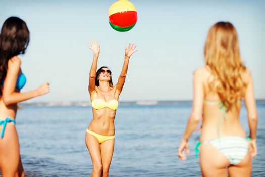 girls with ball on the beach