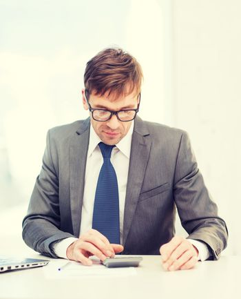 businessman with papers and calculator