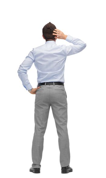 businessman scratching his head from back