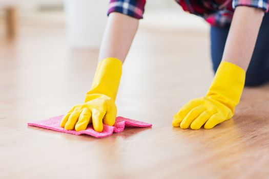 close up of woman with rag cleaning floor at home